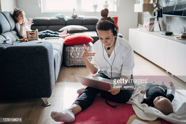 busy single mother working at home and babysitting - working mother stock pictures, royalty-free photos & images