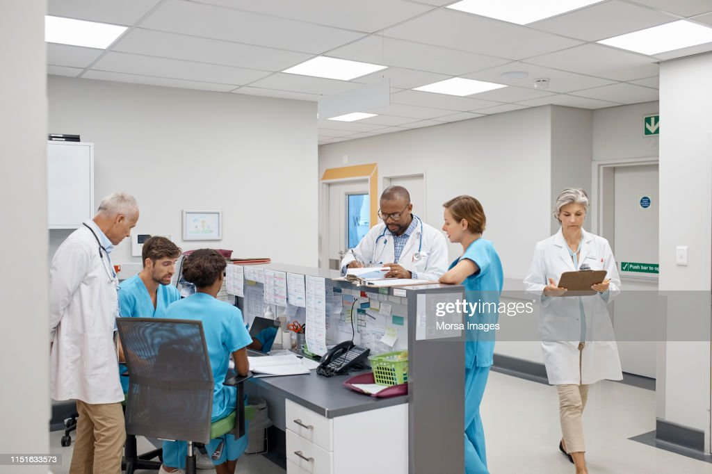 Busy skilled doctors working in hospital : Stock Photo