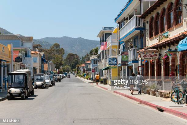 a busy steet on catalina island off the southern california coast - catalina island stock photos and pictures