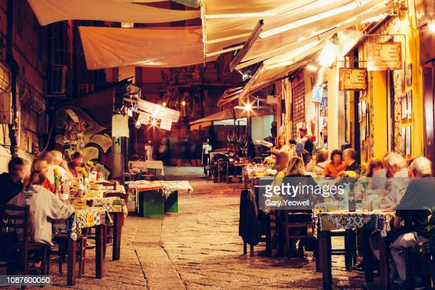 busy street at night in palermo, sicily - mediterranean culture stock pictures, royalty-free photos & images