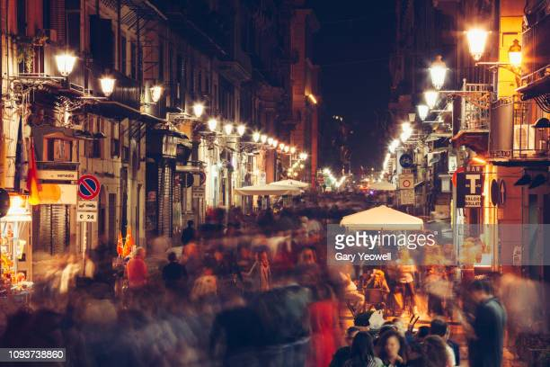 busy street at night in palermo, sicily - pedestrian stock pictures, royalty-free photos & images