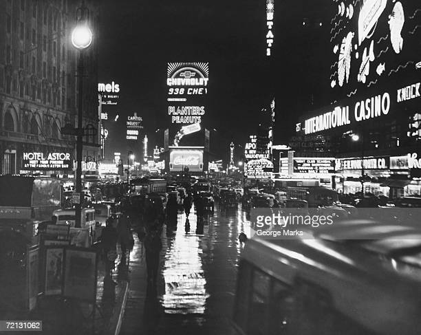 busy street at night, times square, new york, usa (b&w) - 20th century stock pictures, royalty-free photos & images