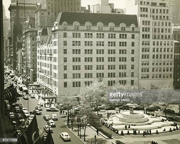 Busy street at Plaza Hotel, New York City, (B&W), (Elevated view)