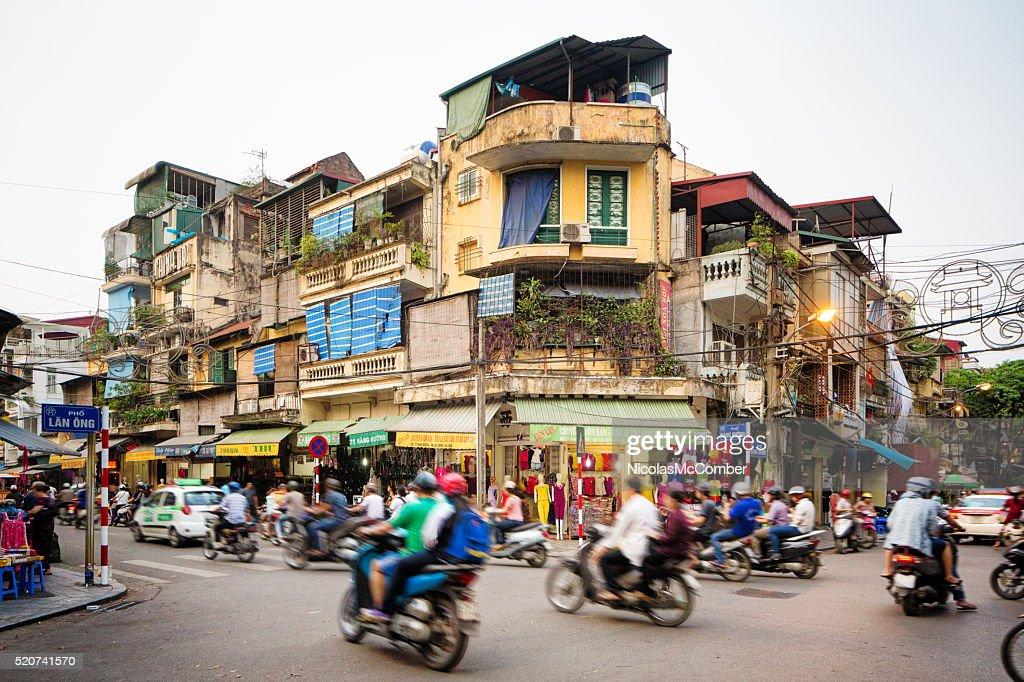 Busy street corner in old town Hanoi Vietnam : Stock Photo