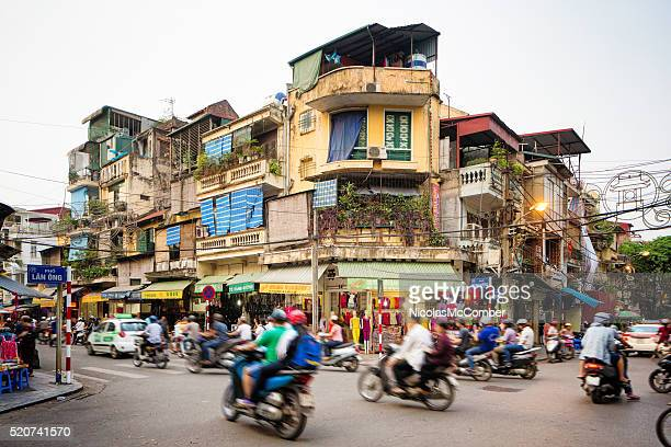 busy street corner in old town hanoi vietnam - vietnam stock pictures, royalty-free photos & images