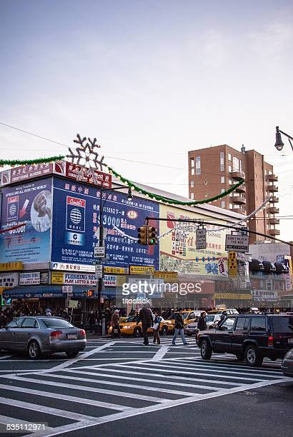 busy street corner - flushing queens stock pictures, royalty-free photos & images