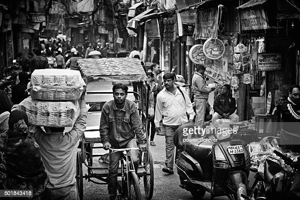 busy street full of people in old delhi, india - old delhi stock pictures, royalty-free photos & images