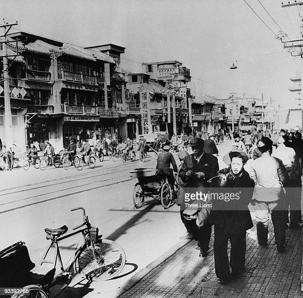 A busy street in Beijing China circa 1965