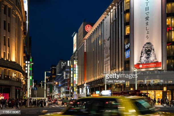 busy street in ginza, tokyo, japan - day of the week stock pictures, royalty-free photos & images