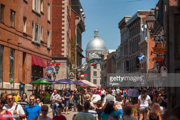 busy street in old montreal quebec canada - vieux montréal stock pictures, royalty-free photos & images