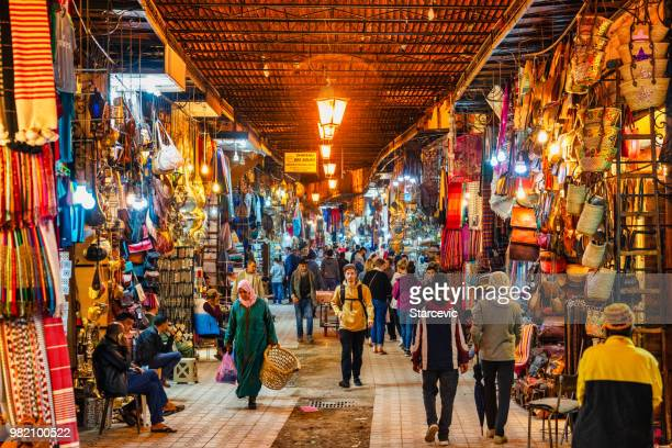 busy street in the souks of marrakech, morocco - marrakesh stock pictures, royalty-free photos & images