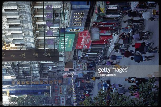 busy street in wuhan - wuhan stock photos and pictures