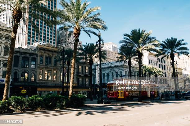 busy street life in downtown new orleans - new orleans stock pictures, royalty-free photos & images