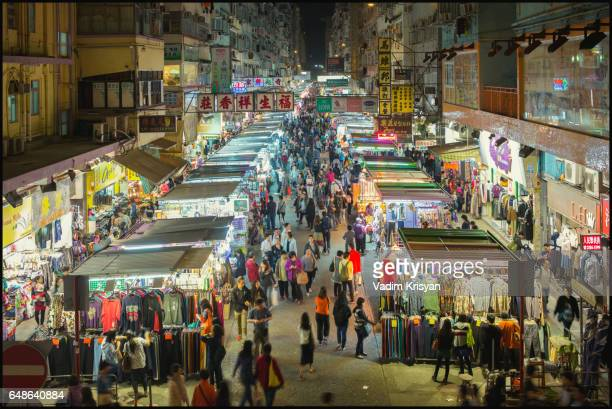 busy street market at night, fa yuen street,  hong kong - vadim krisyan stock pictures, royalty-free photos & images