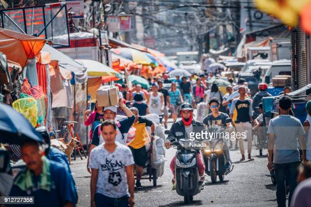 busy street market in manila, philippines - manila stock pictures, royalty-free photos & images