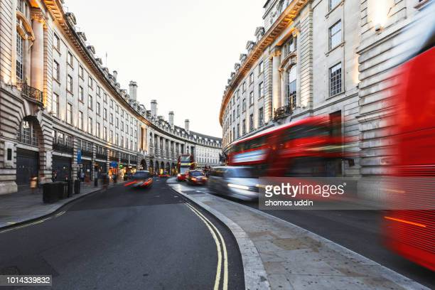 busy street of london at dusk - west end london stock pictures, royalty-free photos & images