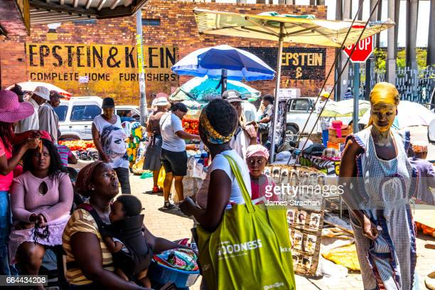 busy street scene in the heart of soweto (south western township), johannesburg, south africa - johannesburg stock pictures, royalty-free photos & images