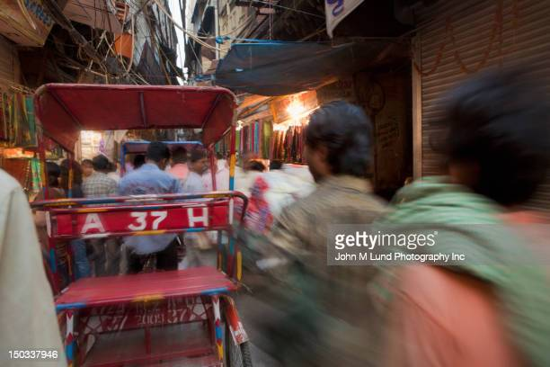 busy street scene of market in delhi, india - old delhi stock pictures, royalty-free photos & images