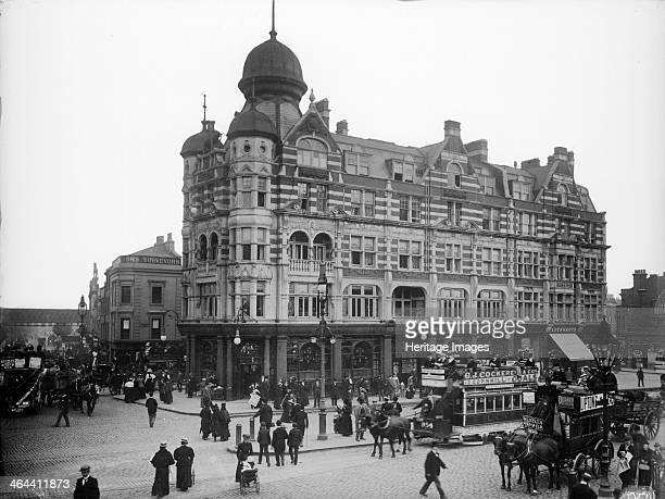 A busy street scene outside the Elephant and Castle tavern Southwark A horse tram and horse drawn onmibus wait at the road junction It was destroyed...