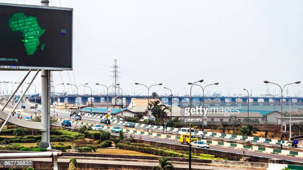 busy streets of african city - lagos, nigeria - lagos stock photos and pictures