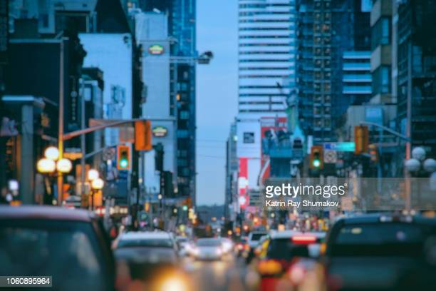 busy streets of blurry blue city - toronto stock pictures, royalty-free photos & images