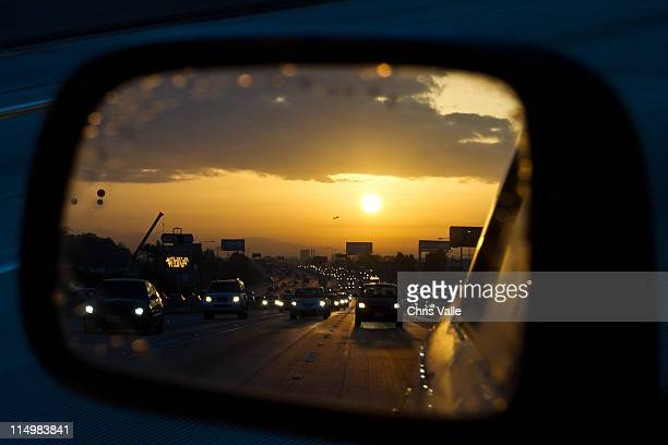busy stretch of freeway reflected in drivers - carson california stock pictures, royalty-free photos & images