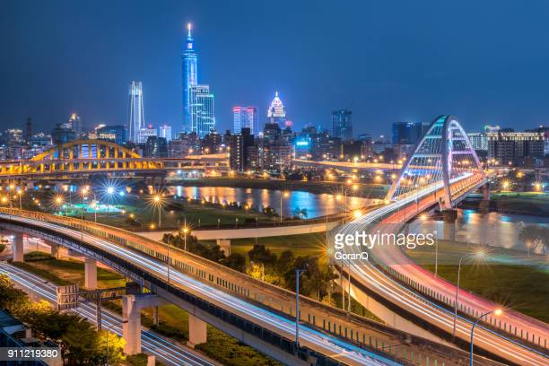 busy taipei bridge after working hours with taipei 101 - taiwan stock photos and pictures