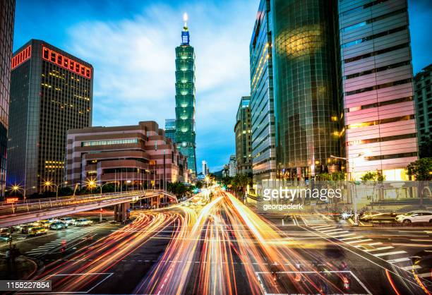 busy taipei streets at dusk - taipei stock pictures, royalty-free photos & images