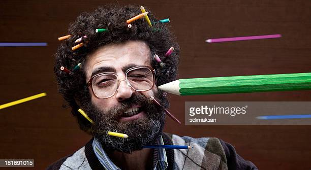Busy teacher confronting flying pencils