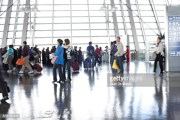 Busy terminal in Shanghai Pudong International Airport