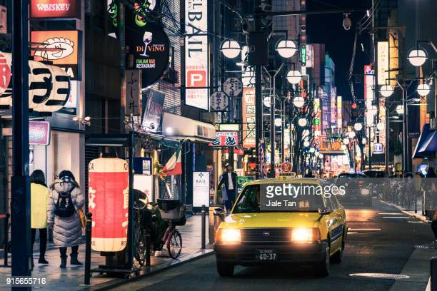 Busy Tourists Waliking In Dotonbori At Night