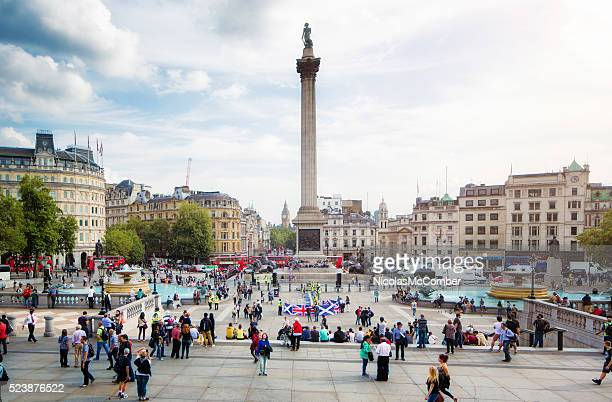 Busy Trafalgar Square London UK on sunny Autumn afternoon