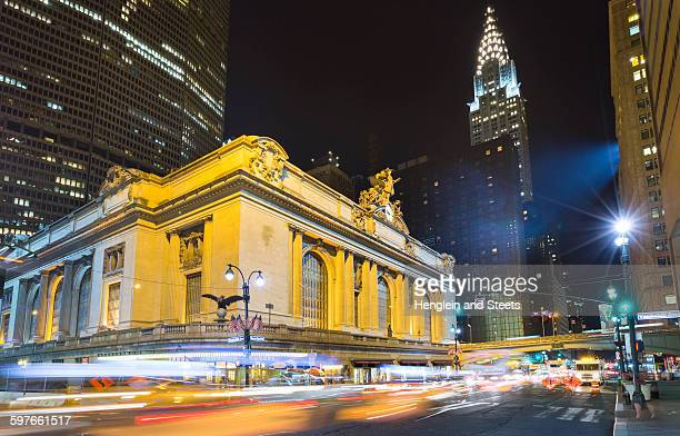 busy traffic and grand central station at night, new york, usa - grand central station stock photos and pictures
