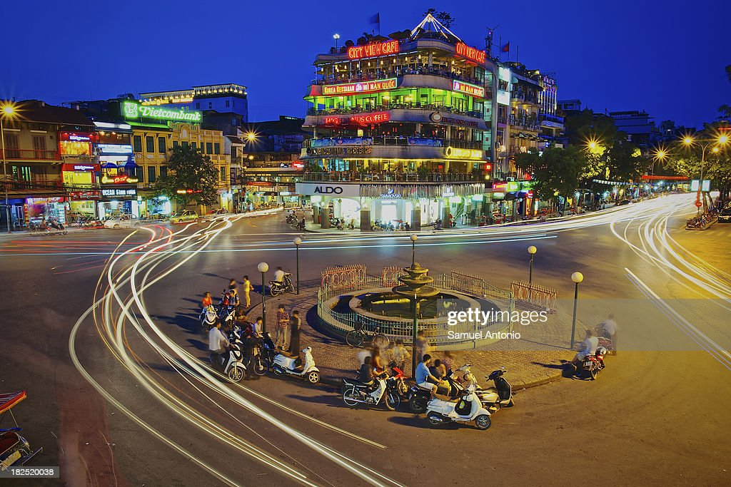 CONTENT] Busy traffic city intersection in the historic Old Quarter of Hanoi, Vietnam. Vietnam's dynamic capital is home to more than six million people and nearly as many motorbikes and scooters. People, Motion, Built Structure, Mode of Transport, City, Architecture, Transportation, Land Vehicle, Horizontal, Outdoors, Asia, Southeast Asia, High Angle View, Vietnam, Car, City Street, Street, Crowded, Sky, Dusk, Night, Hanoi, Road Intersection, Old Town, Color Image, Mixed Age Range, City Life, Group Of People, Large Group Of People, Building Exterior, Photography, Capital Cities, Motor Vehicle, Slow Shutter, Long Exposure, Twilight, City View Cafe