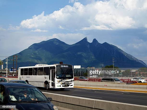 busy traffic downtown monterrey, mexico in front of saddle mountain - nuevo leon state stock pictures, royalty-free photos & images