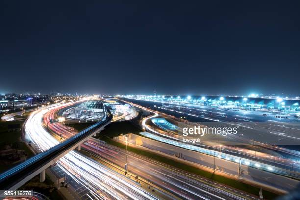 busy traffic from airport  at night in dubai - dubai airport stock photos and pictures