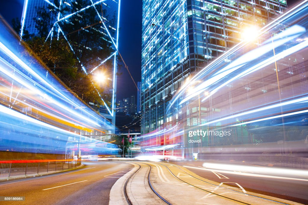 busy traffic on road in midtown of modern city at night : Foto de stock