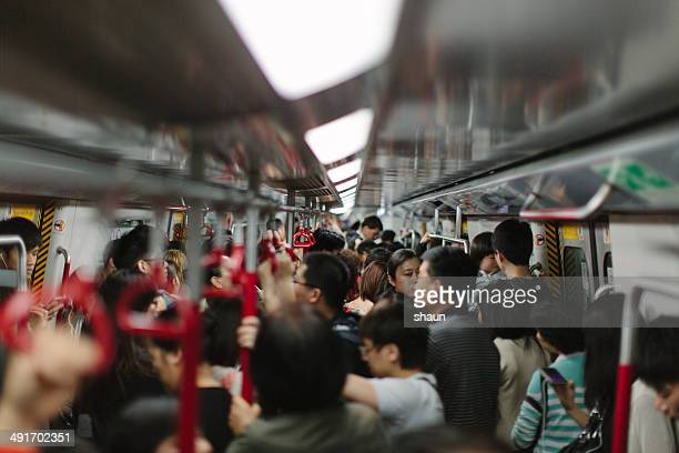 busy train - underground stock photos and pictures