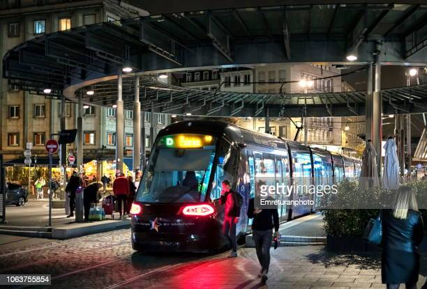 busy tram station in strasbourg city center at night. - emreturanphoto stock pictures, royalty-free photos & images