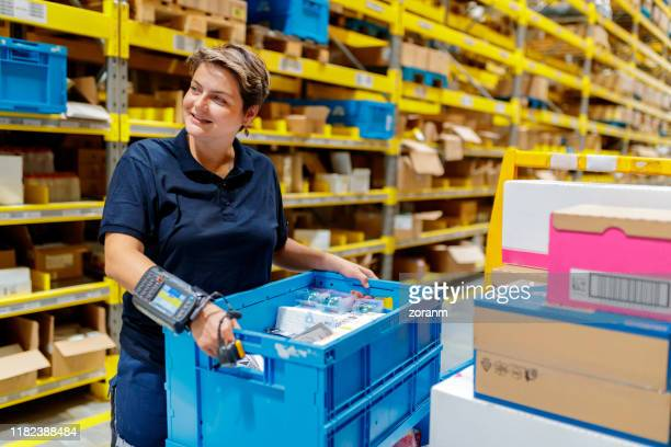busy warehouse worker - wearable computer stock pictures, royalty-free photos & images