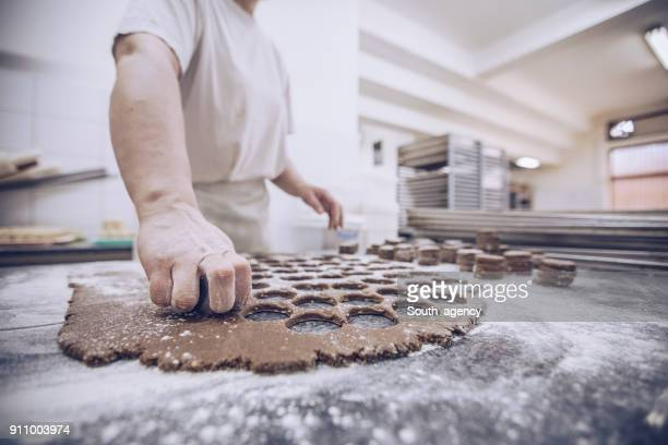 busy woman in bakery - chocolate factory stock pictures, royalty-free photos & images