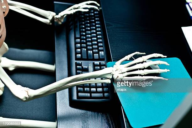busy worker on the computer - funny skeleton stock photos and pictures