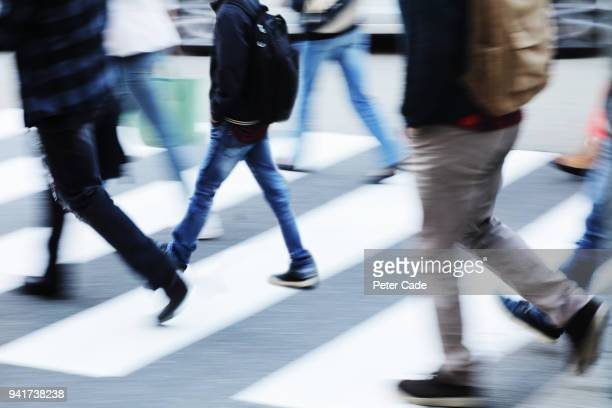 busy zebra crossing - human foot stock pictures, royalty-free photos & images
