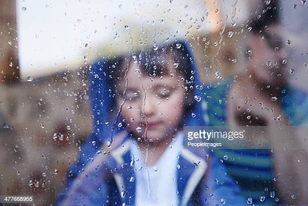 but why can't i play outside mum? - mother son shower stock photos and pictures