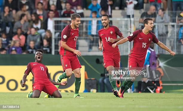 Buta of Portugal celebrates his team's fourth goal with team mates during the UEFA Under19 European Championship match between U19 Germany and u19...