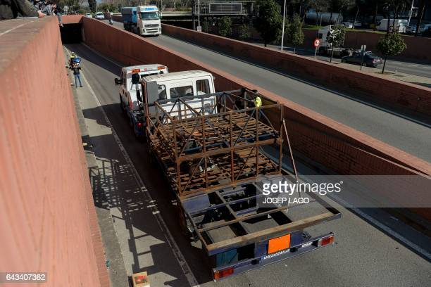 A butane gas delivery truck is towed after being shot by police to stop it in Barcelona on February 21 2017 Spanish police said today they fired on a...