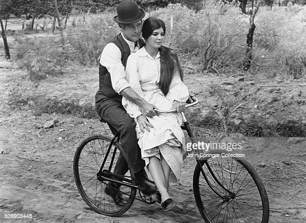 Butch Cassidy and Etta Place ride a bicycle during a scene from the 1969 film Butch Cassidy and the Sundance Kid
