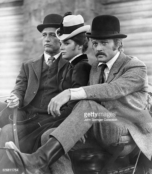 Butch Cassidy , Etta Place , and The Sundance Kid sit on a carriage.