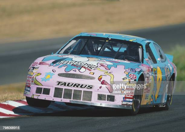 Butch Gilliland driving the Cartoon Network / Happy Birthday NASCAR Ford Taurus during the 1998 NASCAR Winston Cup Series Save Mart / Kragen 350 race...