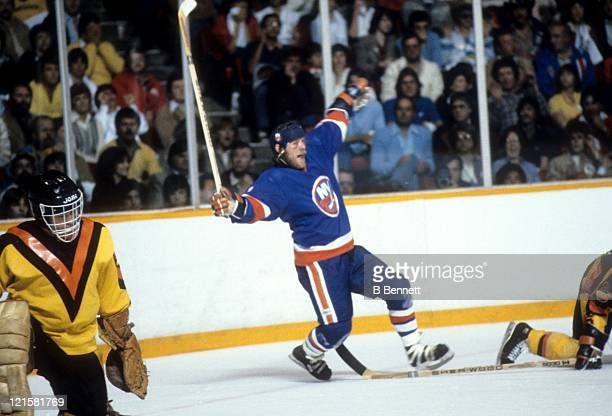 Butch Goring of the New York Islanders celebrates a goal as goalie Richard Brodeur of the Vancouver Canucks looks dejected during the 1982 Stanley...